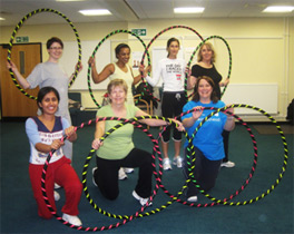 Larger weighted hoops are used for adults which rotate slower and tone as they come into contact with the body